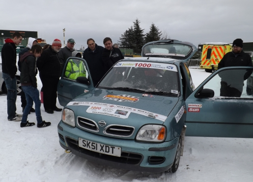 Trainees inspect the safety features on Grahame Douglas's Micra rally car.